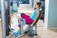 Hip abduction woman exercise at gym indoor. Opening legs workout Stock Photography