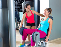 Hip abduction women exercise at gym indoor. Workout and personal trainer smiling Stock Photo