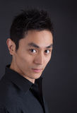 Hip Asian man in black portrait Royalty Free Stock Photos