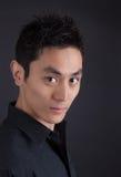 Hip Asian man in black portrait Royalty Free Stock Photos