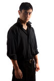Hip Asian man in black portrait. Hip young Asian man against black background stock photography