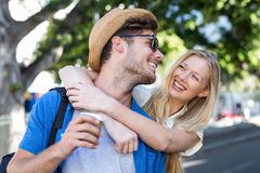 Hip couple embracing and laughing stock image