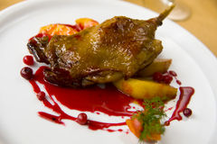 Hip duck fried with vegetables. Cranberry sauce stock image