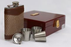 Hip flask 4. A Hip flask, a wooden box, accessories Royalty Free Stock Photography