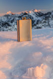 Hip flask on a background peaks. Stock Image