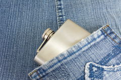 Hip flask in denim jeans pocket Royalty Free Stock Photo