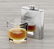 Hip flask and a glass of brandy. On wooden table Stock Image