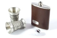 Hip flask and pewter cups Stock Image