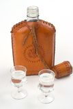 Hip flask and two glasses. Hip flask with with two galsses in front of the flask Stock Image