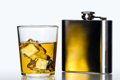Hip flask and Whisky on the rocks Royalty Free Stock Photo