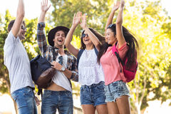 Hip friends cheering up with arms raised Royalty Free Stock Photos