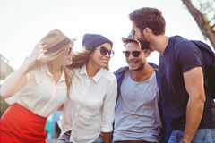 Hip friends having a funny conversation Stock Images