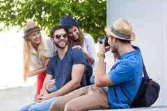Hip friends taking pictures Royalty Free Stock Photography