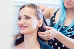 Hip hairdresser styling hair of woman client royalty free stock photos