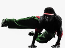 Hip hop acrobatic break dancer breakdancing young man handstand. One hip hop acrobatic break dancer breakdancing young man handstand silhouette white background Stock Photo