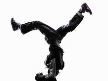 Hip hop acrobatic break dancer breakdancing young man handstand. One hip hop acrobatic break dancer breakdancing young man handstand silhouette white background Royalty Free Stock Photos