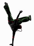 Hip hop acrobatic break dancer breakdancing young man handstand. One hip hop acrobatic break dancer breakdancing young man handstand silhouette white background Stock Images