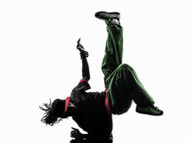Hip hop acrobatic break dancer breakdancing young man handstand. One hip hop acrobatic break dancer breakdancing young man handstand silhouette white background Stock Photos