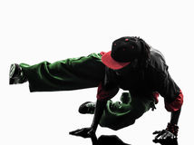 Hip hop acrobatic break dancer breakdancing young man handstand. One hip hop acrobatic break dancer breakdancing young man handstand silhouette white background Royalty Free Stock Photo