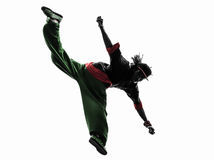Hip hop acrobatic break dancer breakdancing young man jumping si. One hip hop acrobatic break dancer breakdancing young man jumping silhouette white background Royalty Free Stock Photos