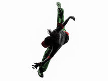 Hip hop acrobatic break dancer breakdancing young man jumping si. One hip hop acrobatic break dancer breakdancing young man jumping silhouette white background Royalty Free Stock Photo