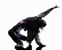 Hip hop acrobatic break dancer breakdancing young man silhouette. One hip hop acrobatic break dancer breakdancing young man silhouette white background Stock Photo
