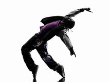 Hip hop acrobatic break dancer breakdancing young man silhouette. One hip hop acrobatic break dancer breakdancing young man silhouette white background Royalty Free Stock Photography