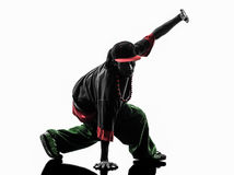 Hip hop acrobatic break dancer breakdancing young man silhouette. One hip hop acrobatic break dancer breakdancing young man silhouette white background Stock Images