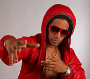Hip hop artist. In shiny red urban outfit Royalty Free Stock Photography
