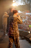 Hip-hop band. Hip hop band members on stage from the back at a live outdoor concert stock photography