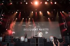Hip hop band singing live. BONTIDA, ROMANIA - JULY 18, 2018: American Hip hop band Delinquent Habits singing live during a concert at Electric Castle festival royalty free stock photo