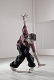 Hip-hop boy in dance studio. Hip-hop boy posing in dance studio royalty free stock images