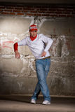 Hip hop boy dancing in modern style over brick wal Royalty Free Stock Photography
