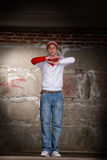 Hip hop boy dancing in modern style over grey wall Royalty Free Stock Images