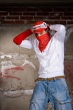 Hip hop boy dancing in modern style over grey wall Stock Image