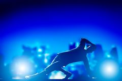 Hip hop, break dance performed by young man in city lights. Royalty Free Stock Images