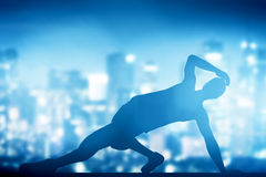 Hip hop, break dance performed by young man in city lights Royalty Free Stock Photo