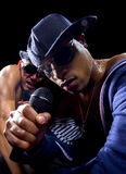 Hip Hop Concert with Rappers. Rappers having a hip hop music concert with microphones on a black background royalty free stock photo