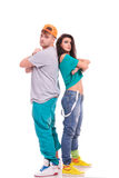 Hip hop couple back to back. Man and women hip hop dancers standing back to back with arms folded and looking at the camera Royalty Free Stock Image
