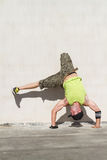 Hip hop dance. A man standing on his head doing hip hop dance outdoors royalty free stock photo