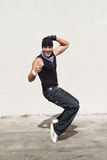 Hip hop dance. Young man doing hip hop dance outdoors Royalty Free Stock Photography