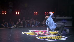 Hip-hop dance show in a nightclub. KIEV, UKRAINE - JUNE 28, 2014: Hip-Hop breakdancer dancing in a nightclub. Break dance competitions in Kiev Red Bull BC One stock video footage