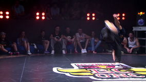Hip-hop dance show in a nightclub. KIEV, UKRAINE - JUNE 28, 2014: Hip-Hop breakdancer dancing in a nightclub. Break dance competitions in Kiev Red Bull BC One stock footage