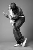 Hip hop dancer. Monochrome image of a hip hop dancer indoor studio stock photo