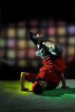 Hip hop dancer. In action under colorful light Stock Photography