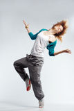 Hip-hop dancer. Teenage girl dancing hip-hop studio series stock photography