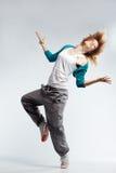 Hip-hop dancer. Teenage girl dancing hip-hop studio series Stock Photography