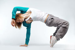 Hip-hop dancer. Teenage girl dancing hip-hop studio series stock photos