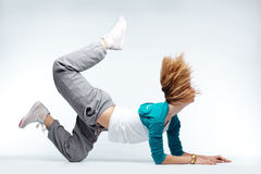 Hip-hop dancer. Teenage girl dancing hip-hop studio series royalty free stock photography