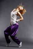 Hip-hop dancer. Teenage girl dancing hip-hop studio series stock images
